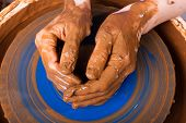 picture of pottery  - hands of potter on pottery wheel - JPG