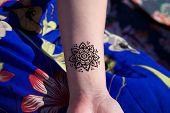 foto of mehendi  - black henna tattoo mehendy on hand mandala - JPG