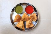 image of samosa  - Indian snack called samosa served with sweet  - JPG
