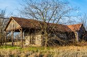 stock photo of log cabin  - Old Abandoned Country Log Cabin Store in Rural Oklahoma - JPG