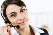 stock photo of helpdesk  - Female call center service operator at work - JPG