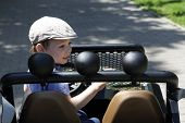 picture of  jeep  - Child driving a jeep in the park - JPG