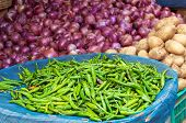 picture of karnataka  - Pile of fresh green chili peppers onions potatoes on the street market - JPG
