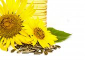 pic of sunflower  - Bottle of sunflower oil with sunflower isolated on white background - JPG