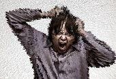 picture of screaming  - An Asian office guy is stressing and screaming to his limit until all surrounding burst off into shatter blocks in heavy grain grunge style - JPG