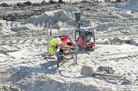 picture of vibration plate  - Wheelbarrow full of waste pipes - JPG