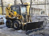 pic of cleaning service  - A road vehicle for excavating ground and cleaning snow - JPG