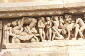picture of kamasutra  - Sculptures of loving couples illustrating the Kama Sutra on walls of Lakshmana Temple at Khajuraho in India Asia - JPG