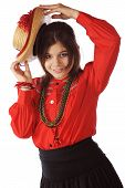 pic of senorita  - An attractive young senorita dancing with a straw hat - JPG