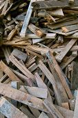 Pile of old used timber planks