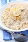 Porridge with banana and honey.  Healthy oatmeal breakfast.