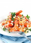Shrimp or prawns with lemon rind, chili flakes and goat's cheese.