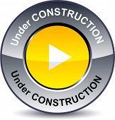 Under construction round metallic button. Vector.