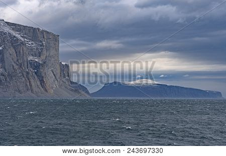 Looming Cliffs In A Glacial