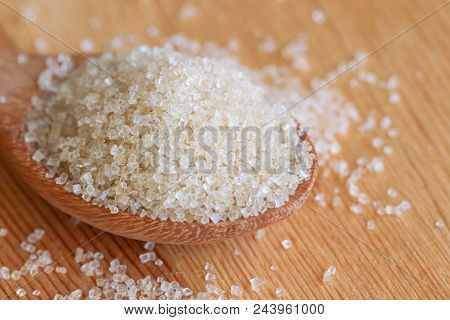 poster of Natural Brown Sugar Or No Bleach Sugar On Wooden Spoon. Organic Brown Sugar Put On Wood Table In Clo