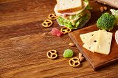 Preparing Ham And Cheese Sandwiches For School Lunchbox On Wooden Background, Close Up. Healthy Eati poster