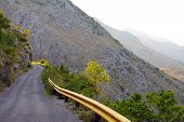 narrow winding road in the mountains