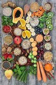 Healthy high fibre super food with fruit, vegetables, pulses, nuts, seeds, cereals and grain with fo poster