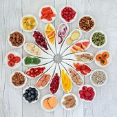 Health food for a healthy heart concept with super foods of fruit, vegetables, fish, nuts, seeds, he poster