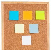 Photo of notes posted to a cork board