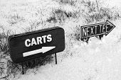 Cart And Next Tee Sign On A Snow Covered Golf Course