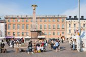 Market Square And  Stern Obelisk Of Empress Alexandra In Helsinki