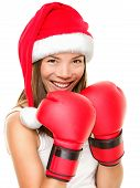 foto of boxing day  - Christmas fitness boxing woman wearing santa hat and red boxing gloves - JPG