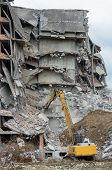 Heavy Equipment Being Used To Tear Tearing Down Building Construction poster