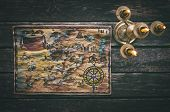 Pirate Treasure Map And Burning Candle On Aged Wooden Table Background. Treasure Hunt Concept. Sea T poster