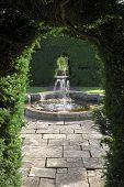 Fountain In English Country Garden