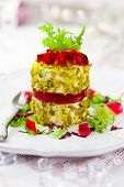 Goat's cheese with pistachio crust and berries jelly for Christmas