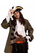 stock photo of buccaneer  - Portrait of young man in a pirate costume with pistol - JPG