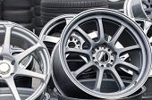 Wheel Rims On Showcase. Car Alloy Wheels At A Wheel Shop poster