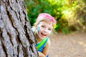 children little girl happy playing in forest tree with party makeup