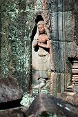 stock photo of asura  - Statue carving on mandapa Siem Reap Cambodia