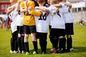 Kids Sports Team With Coach. Team Sports For Children. Young Boys Standing Together As A Teammates H poster