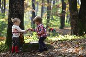 Little Boy And Girl Friends Camping In Woods. Childhood And Child Friendship, Love And Trust. Brothe poster