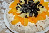 Fruit Tart Mango Whole Cake Topped With Mango, Pineapple, And Grapes. Pastry Cake poster