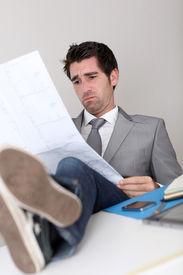 image of stressless  - Stressless businessman looking at construction plan - JPG