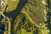 Aerial View Of Town And River Marsh Landscape In Sunny Summer Day. Top View Of Beautiful European Na poster