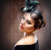Retro Beauty Portrait. Vintage Styled. Beautiful Young Woman