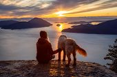 Adventurous Girl Hiking On Top Of A Mountain With A Dog During A Colorful Sunset. Taken On Tunnel Bl poster