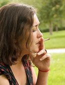 woman smoking a rolled cigarette
