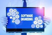 Writing Note Showing Software Engineering. Business Photo Showcasing Apply Engineering To The Develo poster
