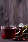Red Hot Hibiscus Tea. Healthy Lifestyle.hot Drinks.three Glass Cups With Black, Red And Green Tea Wi poster