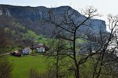 Norwegian Village On The North Sea In Spring Time. Village In The Mountains By The Sea In Norway. Re poster