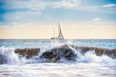 Seascape With White Sailboat, Blue Water And Surf Wave On Foreground poster
