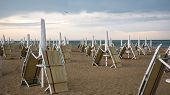 Sunbeds And Parasols Collapsed Due To The Upcoming Storm poster