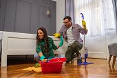 Woman Is Lazy. Man Is Telling Her To Continue Cleaning Their Apartment. poster