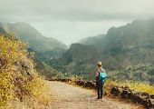 Santo Antao Island Cape Verde. Female Tourist With Backpack Enjoying Hiking Path Route To Paul Valle poster